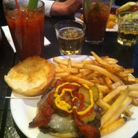 Photo taken at Turtle's Bar and Grill by Scott R. on 5/12/2013