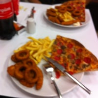 Photo taken at Pizza Pizza by Oguzhan G. on 3/19/2014