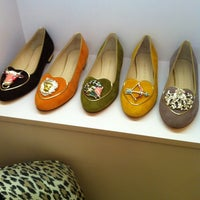 Photo taken at Charlotte Olympia by Aiman M. on 10/24/2013