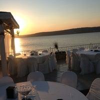 Photo taken at Marina Restaurant Cafe & Bar by Bugra Ç. on 9/8/2013