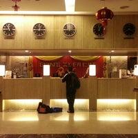 Photo taken at Crown Garden Hotel by Mett A. on 2/5/2013