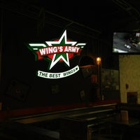 Photo taken at Wings Army by Eduardo Y. on 4/4/2013