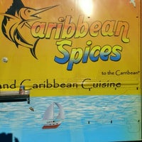 Photo taken at caribbean spices by Adam T. on 7/21/2016