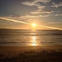 Photo taken at Praia do Mariscal by Mateus C. on 1/1/2013