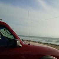 Photo taken at Explanada Playa Municipal by J. Ricardo C. on 3/19/2014