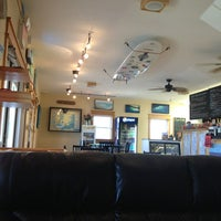Photo taken at Waveriders Coffee & Deli by Kim C. on 5/15/2013