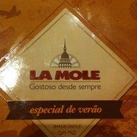 Photo taken at La Mole by Aline S. on 3/23/2013