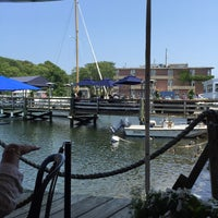 Photo taken at Shuckers Raw Bar by MJ L. on 7/1/2015