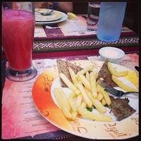 Photo taken at Reem al Bawadi مطعم ومقهى ريم البوادي by Scooby S. on 1/3/2013