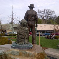 Photo taken at Yoda Statue by Joan D. on 3/9/2014