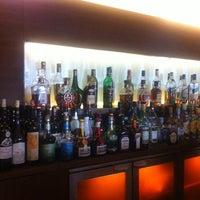 Photo taken at Papa Cigar Lounge Bar by Di T. on 3/13/2013
