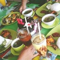 Photo taken at Warung Seafood Bang Pasha by Yolanda D. on 5/12/2013