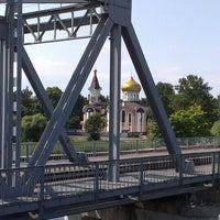 Photo taken at Buļļupes tilts by Karlis S. on 7/14/2013