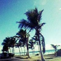 Photo taken at Praia de Ipitanga by AnaTaís N. on 2/12/2013