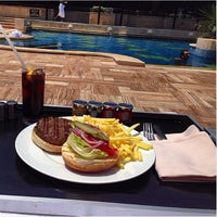 Photo taken at Grand Hyatt Poolside Cabanas by Roy D. on 6/19/2014