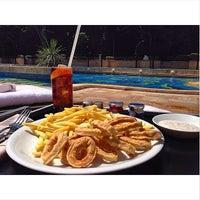 Photo taken at Grand Hyatt Swimming Pool by Roy D. on 8/6/2014