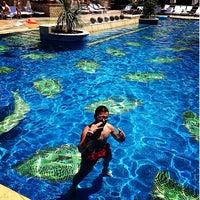 Photo taken at Grand Hyatt Swimming Pool by Roy D. on 8/10/2014