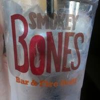 Photo taken at Smokey Bones Bar & Fire Grill by Nicki W. on 2/9/2013