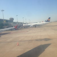Photo taken at Gate 234 by Cemal Y. on 9/10/2013