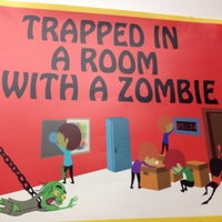 Photo taken at Room Escape Adventures - With a Zombie by Amy T. on 8/23/2014