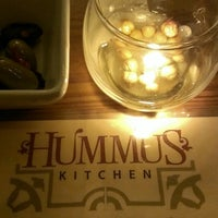 Photo taken at Hummus Kitchen by Amy T. on 3/6/2013