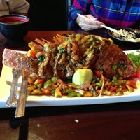 Photo taken at Sushi Island by Amy T. on 6/18/2013