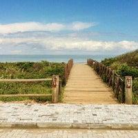 Photo taken at Praia Brava by Antonio D. on 3/18/2013