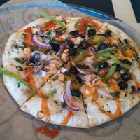 Photo taken at Pieology Pizzeria by Aaron G. on 1/10/2014