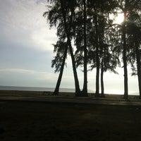 Photo taken at Batu burok beach by Amir A. on 8/11/2013