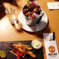 Photo taken at Manchester United Red Café by Jocelyn K. on 1/23/2013