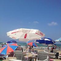 Photo taken at Yelken Beach by Baris I. on 8/25/2013