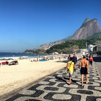 Photo taken at Ipanema Beach by Eduardo S. on 6/4/2013