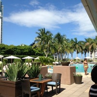 Photo taken at Four Seasons Hotel Miami by Deniece W. on 7/6/2013