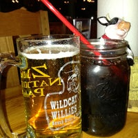 Photo taken at Wildcat Willie's Ranch Grill & Saloon by Laetiz on 3/31/2013