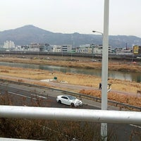 Photo taken at 군자교 by 관모 연. on 2/26/2013