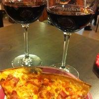 Photo taken at La Competencia Pizzeria by Gema G. on 3/9/2013