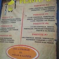 Photo taken at Pollos Ahumados Flaviu's by cesar h. on 1/18/2014