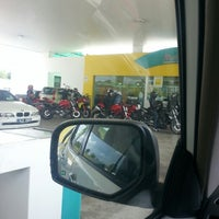 Photo taken at Petronas by Shirley T. on 5/26/2013