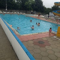 Photo taken at Outdoor Swimmng Pool by Mutlu H. on 8/14/2013