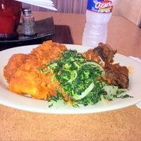 Photo taken at Trinity African Bar & Grill by Ike U. on 3/25/2014