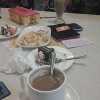 Photo taken at Milo Cafe by Padilah N. on 2/13/2013