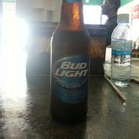 Photo taken at Village Road Liquor Store by Alex W. on 7/7/2013