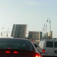 Photo taken at Johns Pass Bridge by Michele D. on 4/19/2013