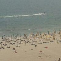 Photo taken at Kudos Beach by Christos E. on 6/11/2013