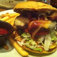 Photo taken at Outback Steakhouse by Tony M. on 10/23/2012