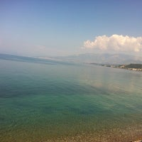 Photo taken at Tarandella Beach by Ioanna N. on 8/10/2014