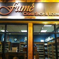 Photo taken at Fume Cigar Shop & Lounge by cetin t. on 3/12/2013