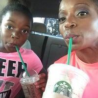 Photo taken at Starbucks by j n. on 10/4/2014