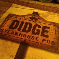 Photo taken at Didge Steakhouse Pub by Julio L. on 4/2/2013
