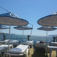 Photo taken at Palm beach by Volkan B. on 6/24/2013